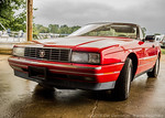 Red Cadillac Allante, from the 1991 model year.  Photographed using Leica X2 digital camera with Elmarit 24mm f/2.8 lens; APS-C sensor (23.6mm x 15.8mm), 16.2 megapixels; set to f/6.3 at 1/8 ...